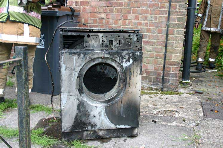 Stock image of a burnt out washing machine