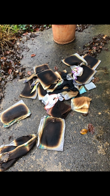 Damage to tea towels which were left stacked after being taken from the tumble dryer