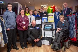 PCSO Alex Franklin photographed with the team from Isebrook College, with teachers and Kettering's mayor James Burton