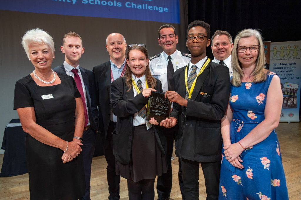 Judges with the winners of this year's Northamptonshire County Schools Challenge: Corby Technical School