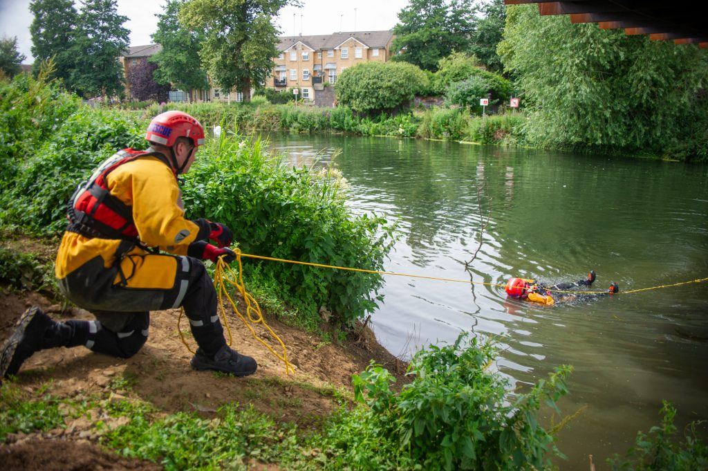 Staged water rescue is carried out by firefighters