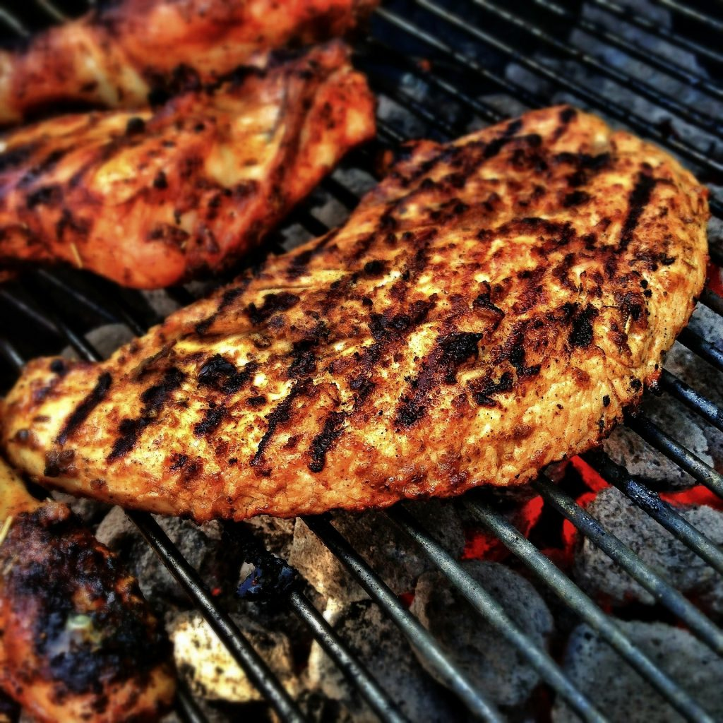 Image of meat on a barbecue