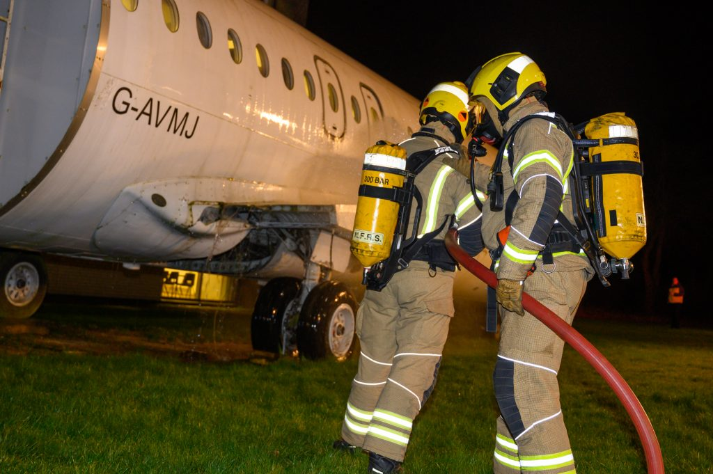 Firefighters tackle plane fire in training scenario