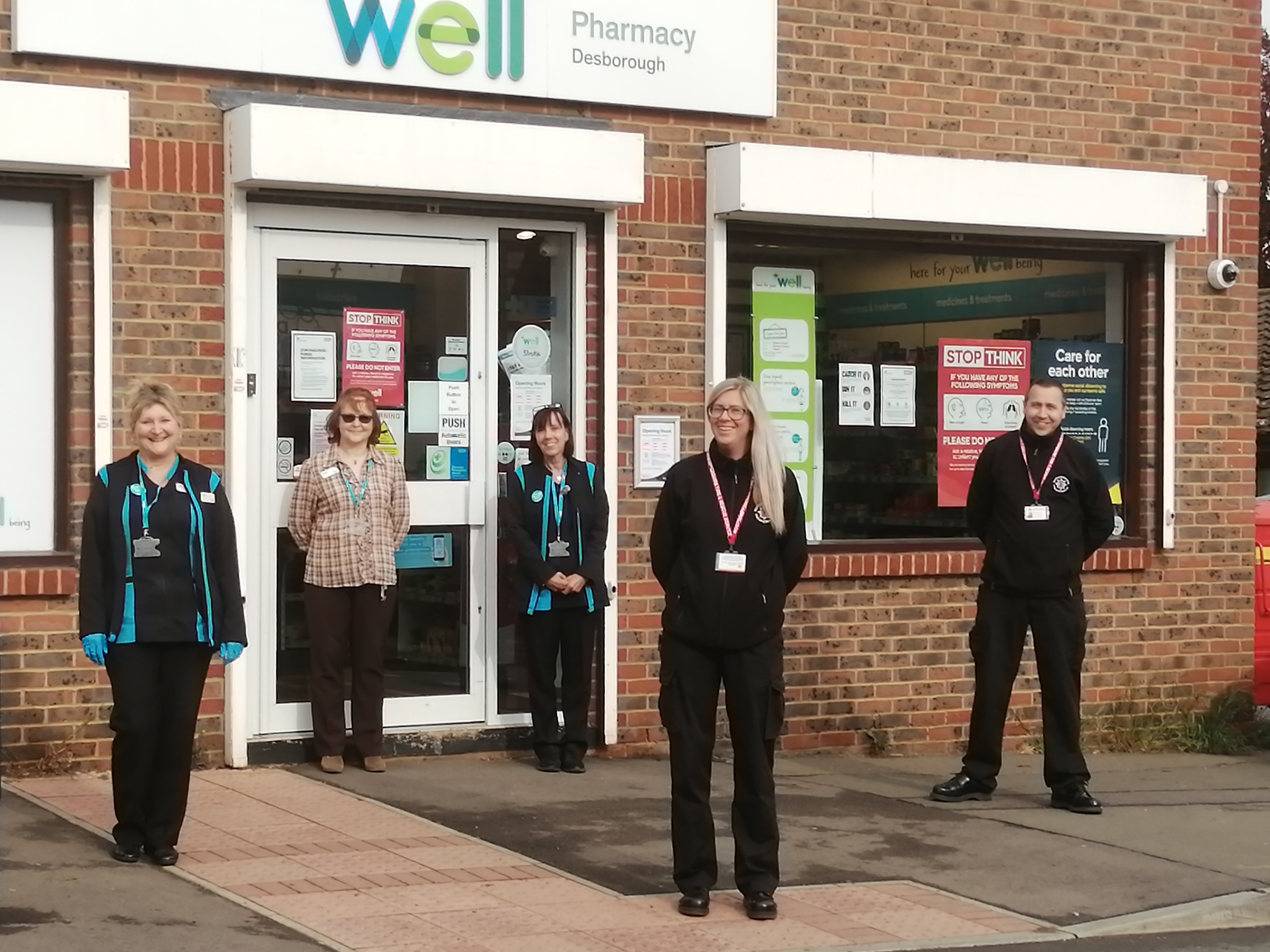 Pharmacy staff in Desborough with two of the on-call firefighters