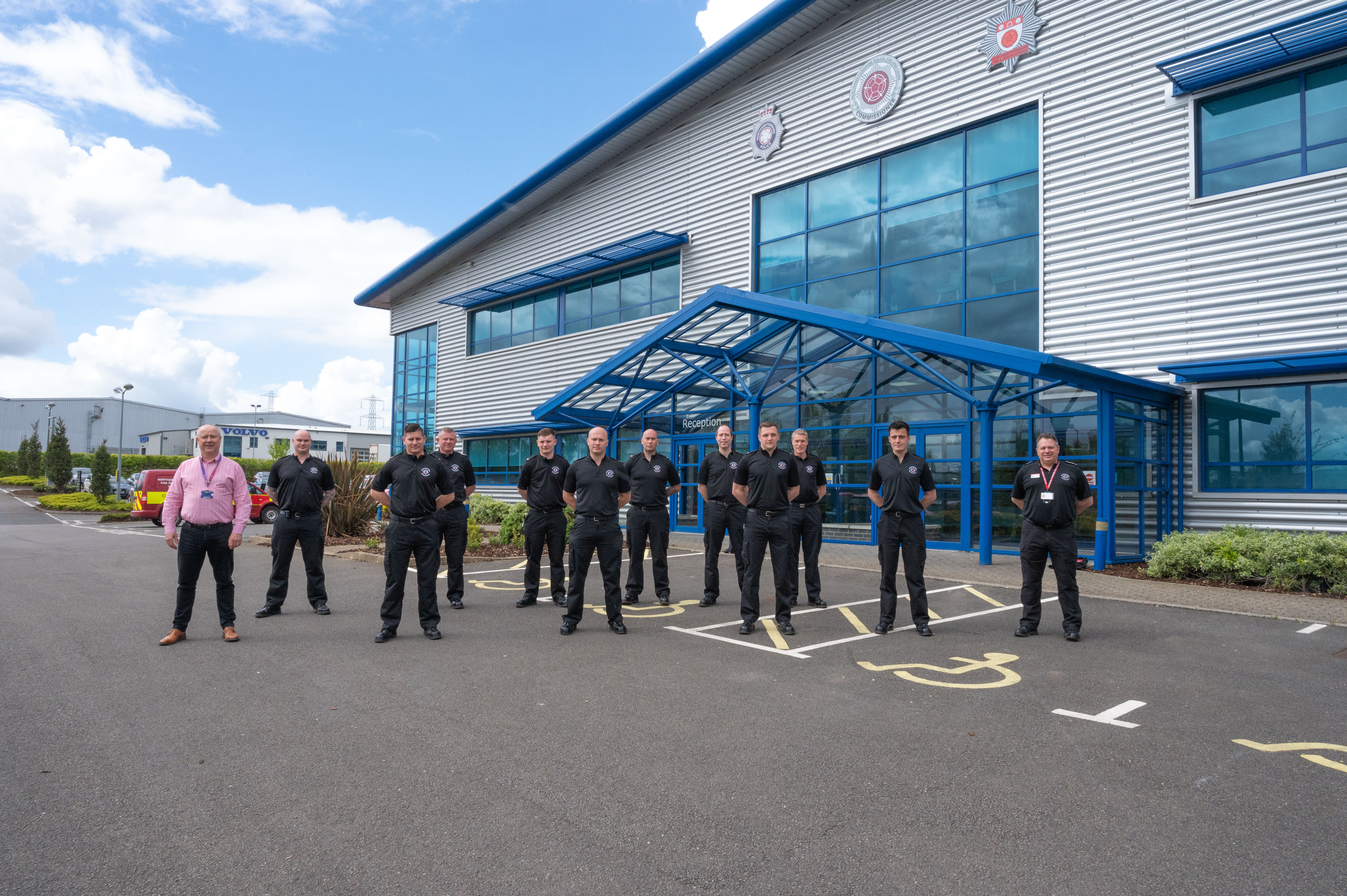Photo showing new recruits standing outside joint building at Wellingborough